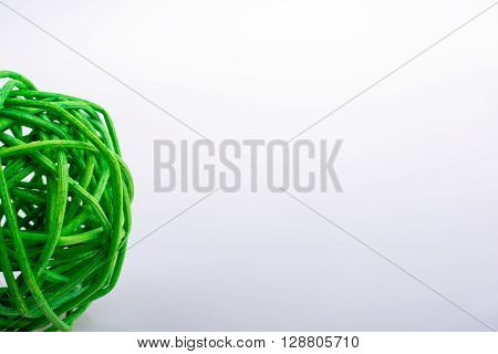 little green wooden ball on a white background