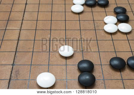 Go game board. Weiqi game board. Stones on a Go board