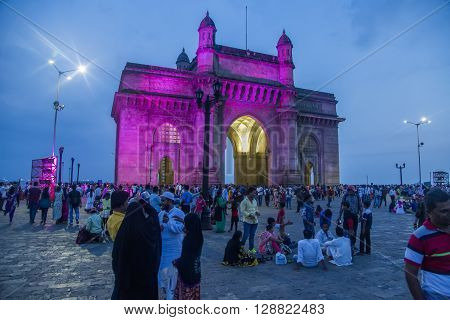 MUMBAI, INDIA - OCTOBER 11, 2015: Unidentified people in front of the Gateway of India. It was built to commemorate the visit of King George V and Queen Mary to Mumbai in December 1911.
