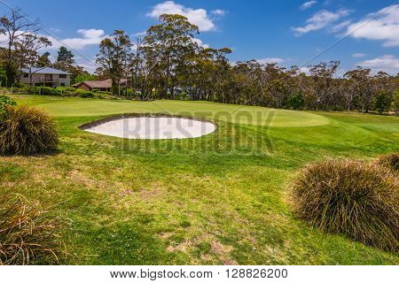 Katoomba Australia - November 10 2014: View of Golf course with a bunker and a good green in a nice day Katoomba New South Wales Australia.
