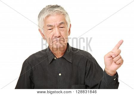 portrait of senior Japanese man doubting on white background
