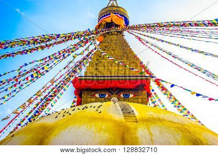 Boudhanath Stupa with the watching eyes of buddha and Colourful Prayer Flags.