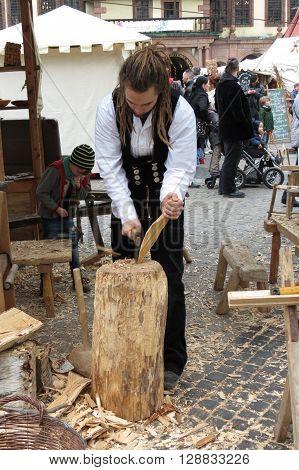 LEIPZIG GERMANY - CIRCA MARCH 2016: rastaman wood worker showing old times jobs