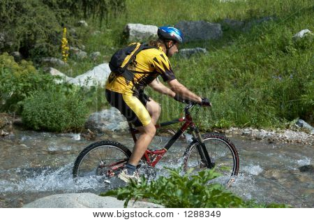 Mountain Biker And Creek