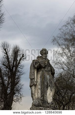 Godmother staring at the sky. Monument near the temple. Lviv