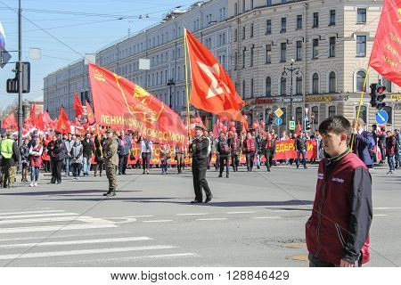 St. Petersburg, Russia - 1 May: People with red banners of Lenin Komsomol, 1 May, 2016. Day festive demonstration on the Nevsky Prospect in St. Petersburg