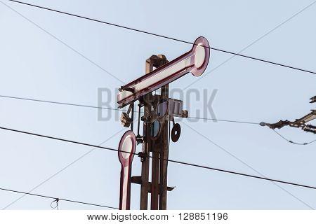 a semaphore train signal on railway line