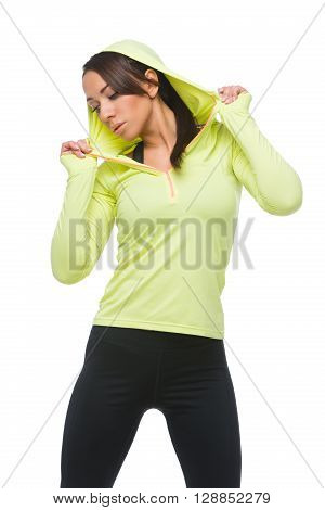 Beautiful sporty fit young woman in green and black sportwear. Isolated over white background.