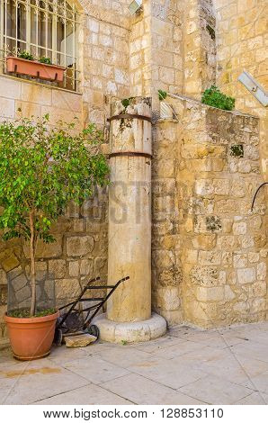 The ruins of the ancient column in the courtyard in Via Dolorosa Jerusalem Israel.