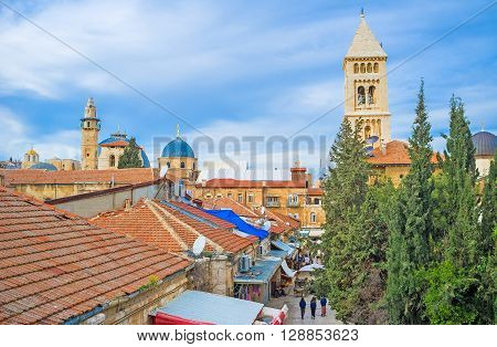 The old city consists of the old stone buildings with the tiled roofs numerous churches mosques and synagogues Jerusalem Israel. poster