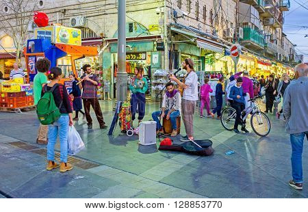 JERUSALEM ISRAEL - FEBRUARY 18 2016: The street musicians sing at the entrance of Mahane Yehuda market on February 18 in Jerusalem.