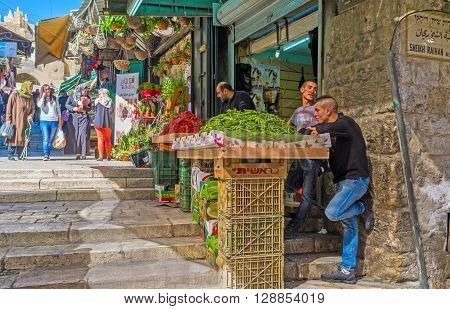 JERUSALEM ISRAEL - FEBRUARY 18 2016: The market stall in Bazaar at Damascus Gate offers the fresh fruits and vegetables on February 18 in Jerusalem.
