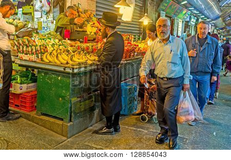 JERUSALEM ISRAEL - FEBRUARY 18 2016: The Mahane Yehuda market is the best place to choose fresh and tasty fruits and vegetables on February 18 in Jerusalem.