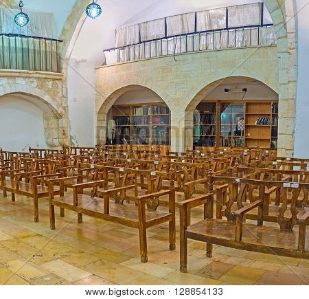 JERUSALEM ISRAEL - FEBRUARY 18 2016: The interior of Eliyahu Hanavi synagogue with the book shelves on the background Four Sephardic Synagogues complex on February 18 in Jerusalem.