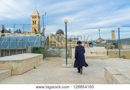 JERUSALEM ISRAEL - FEBRUARY 18 2016: The hasid walks along the roof in the old city on February 18 in Jerusalem.