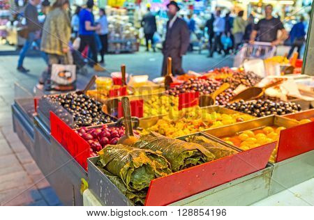 JERUSALEM ISRAEL - FEBRUARY 18 2016: The Mahane Yehuda market offers various marinated olives canned grape leaves pickled peppers and other local cuisines on February 18 in Jerusalem.