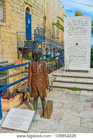JERUSALEM ISRAEL - FEBRUARY 18 2016: The statue of the little girl with her Teddy Bear (Mischke) is memorial to the children - victims of the Holocaust located at the entrance to the museum of Holocaust on February 18 in Jerusalem.