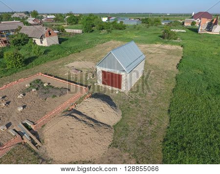Top view of the garage in a private plot of land. Private construction.