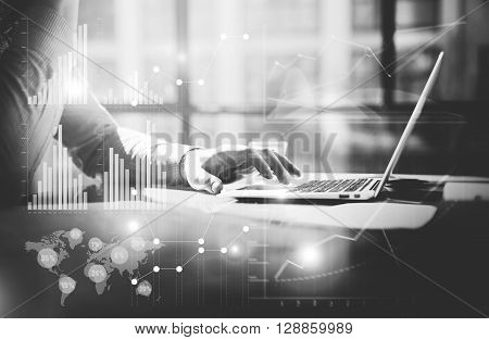 Business concept.Businessman working investment startup project modern office.Work hard contemporary laptop.Worldwide connection technology, stock exchanges graphic interfaces.Horizontal. Black white