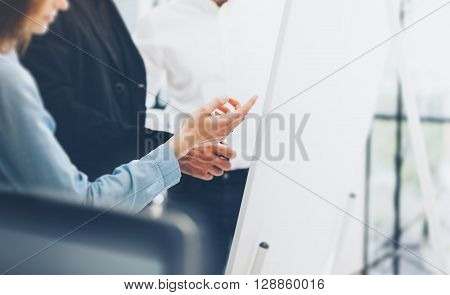 Business meeting office.Woman showing presentation idea chart board.Photo account managers crew working with startup project.New project, analyze marketing plans.Blurred, film effect.
