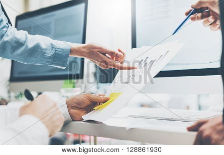 Business meeting office, closeup photo documents holding man hands. Photo account managers crew working with new startup project.Idea presentation, analyze marketing plan.Blurred, film effect, horizontal.