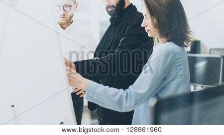 Business meeting image.Photo man writing statistic info chart board.Photo creative department working with new startup project. Idea presentation, analyze plan, brainstorming.Film effects.Horizontal.