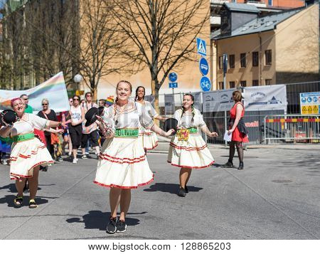 NORRKOPING, SWEDEN - MAY 7, 2016: Norrkoping Pride Parade 2016 marching in Norrkoping.  The first Pride parade in Norrkoping was run in 2012.
