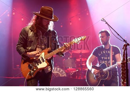 NEW YORK-MAY 6: Singers T.J. Osborne (R) and John Osborne of Brothers Osborne perform onstage at the Paramount on May 6, 2016 in Huntington, New York.