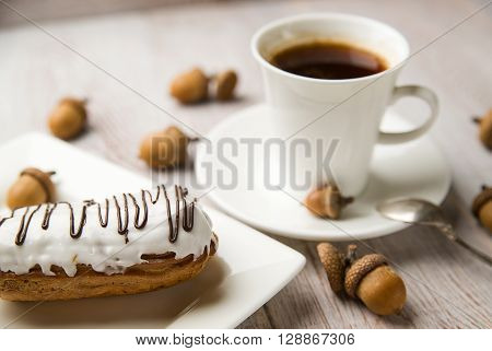 Cup of coffee sweet buns and brown acorns ** Note: Visible grain at 100%, best at smaller sizes