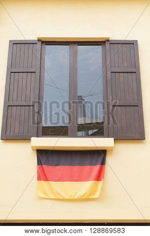 Wooden Window With Tinted Glass Decorating With Germany National Flag
