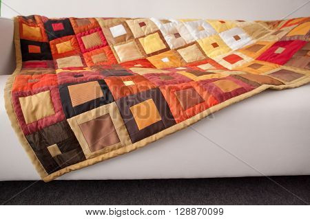 Patchwork quilt. Part of patchwork quilt as background. Klimt print. Color blanket. Handmade.