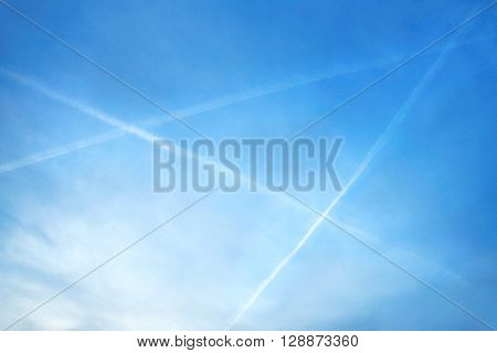 Evening picture of blue sky with white triangle creating three planes over the Krusne hory Mountains in northern Bohemia
