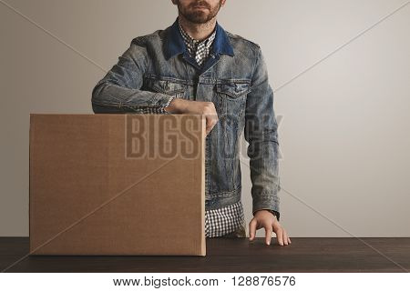 Bearded Brutal Courier In Jeans Work Jacket Stays Near Presented Big Carton Paper Box With Goods On