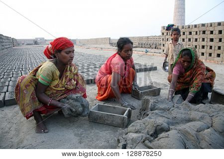 SARBERIA,INDIA, JANUARY 14: labourers prepare bricks at a brick kiln in Sarberia, West Bengal, India on January 14, 2009. The Indian brick industry is the second largest in the world after China.