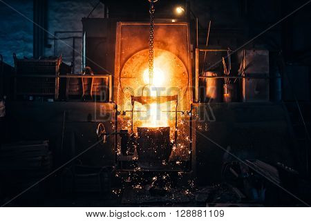 Smelting metal in a metallurgical plant. Liquid iron from metal ladle pouring in castings at factory ** Note: Visible grain at 100%, best at smaller sizes