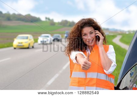 Female Driver Giving A Thumbs Up Gesture
