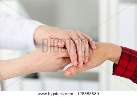 Friendly Female Doctor Hands Holding Woman Patient Hand