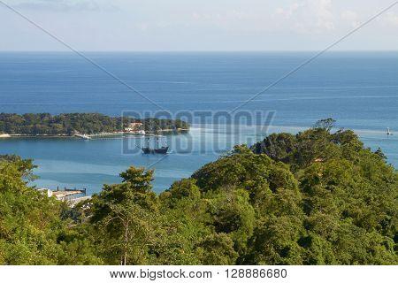Bay and laguna with a boat in Roatan in Honduras.