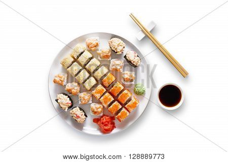 Japanese food restaurant, sushi maki gunkan roll plate or platter set. Set for two with chopsticks, ginger, soy, wasabi. Sushi isolated at white background. Top view, flat lay.