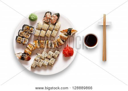 Japanese food restaurant, unagi sushi maki gunkan roll plate or platter set. Set for two with chopsticks, ginger, soy, wasabi. Sushi isolated at white background. Top view, flat lay.