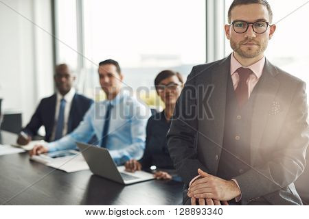 Handsome Caucasian Executive With Three Employees