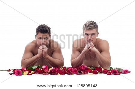 Image of two handsome men posing naked with rose petals