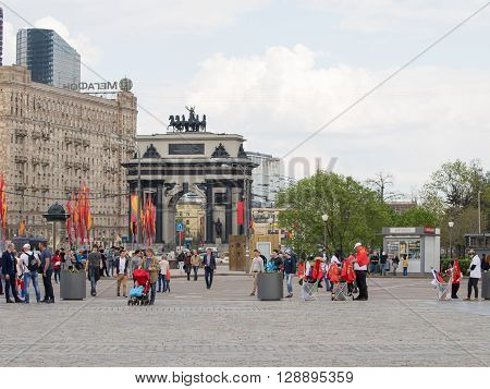 Moscow - May 6 2016: Arc de Triomphe on Kutuzov Avenue and people walk in Victory Park on Poklonnaya Hill in May holidays May 6 2016 Moscow Russia