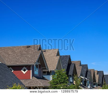 Modern residential buildings against blue sky in North America.