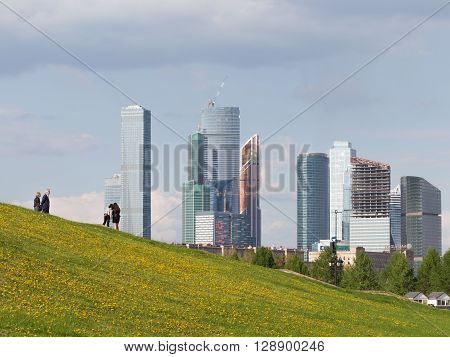 Moscow - May 6 2016: The complex of skyscrapers Moscow City a beautiful view from the Poklonnaya Hill and people walk in Victory Park May 6 2016 Moscow Russia