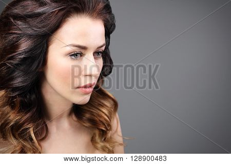 Portrait of sensual woman laying hair .