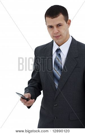 Successful young businessman dials the phone - isolated
