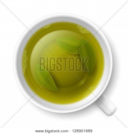 Cup of green tea with tea leaves at the bottom over white background