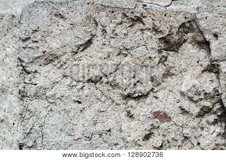 Background texture of old gray concrete fence with hexahedron pattern