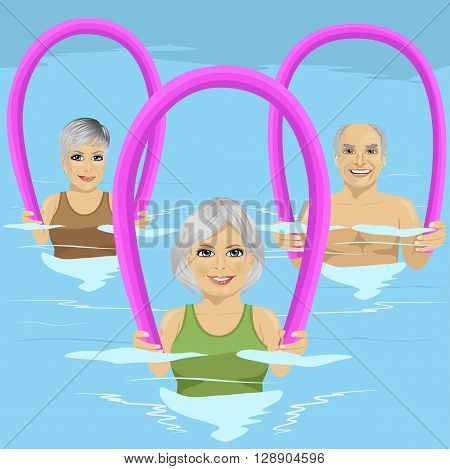 Senior people in fitness class doing aqua aerobics with foam rollers in swimming pool at the leisure centre